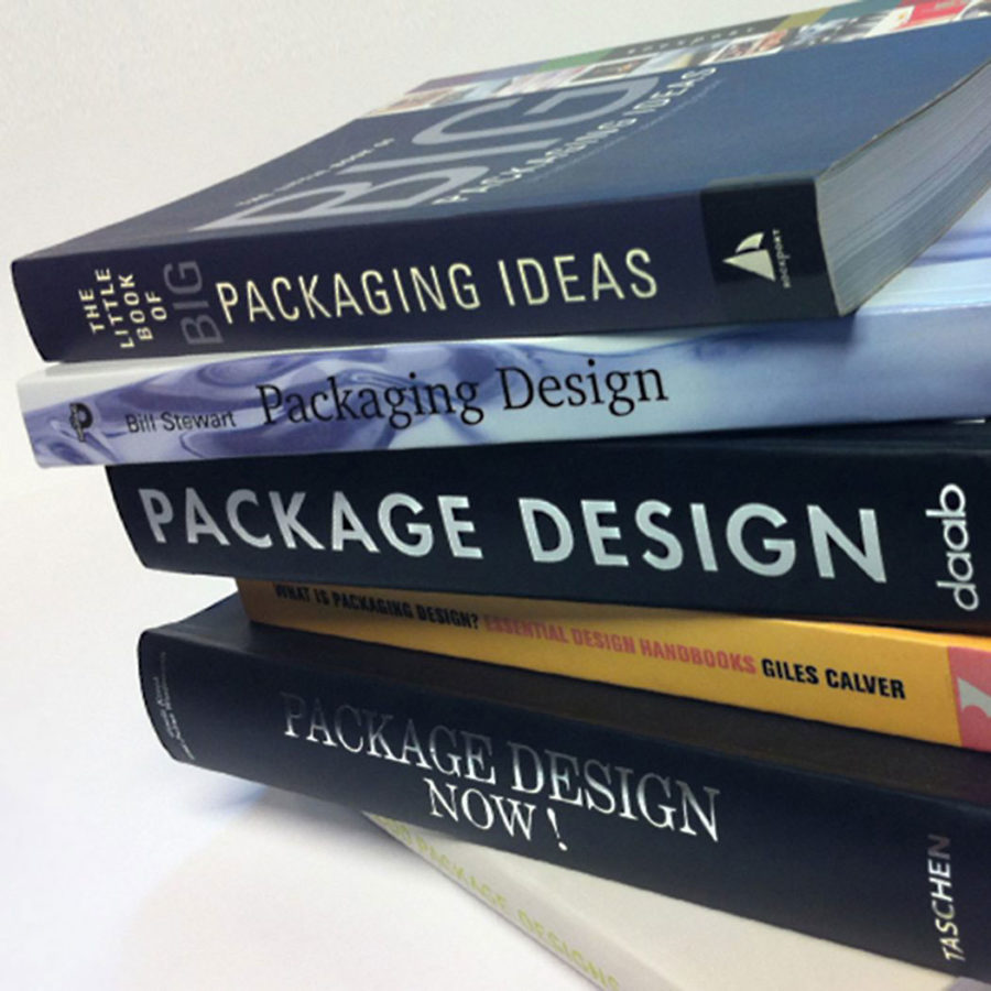 stacked packaging design books.