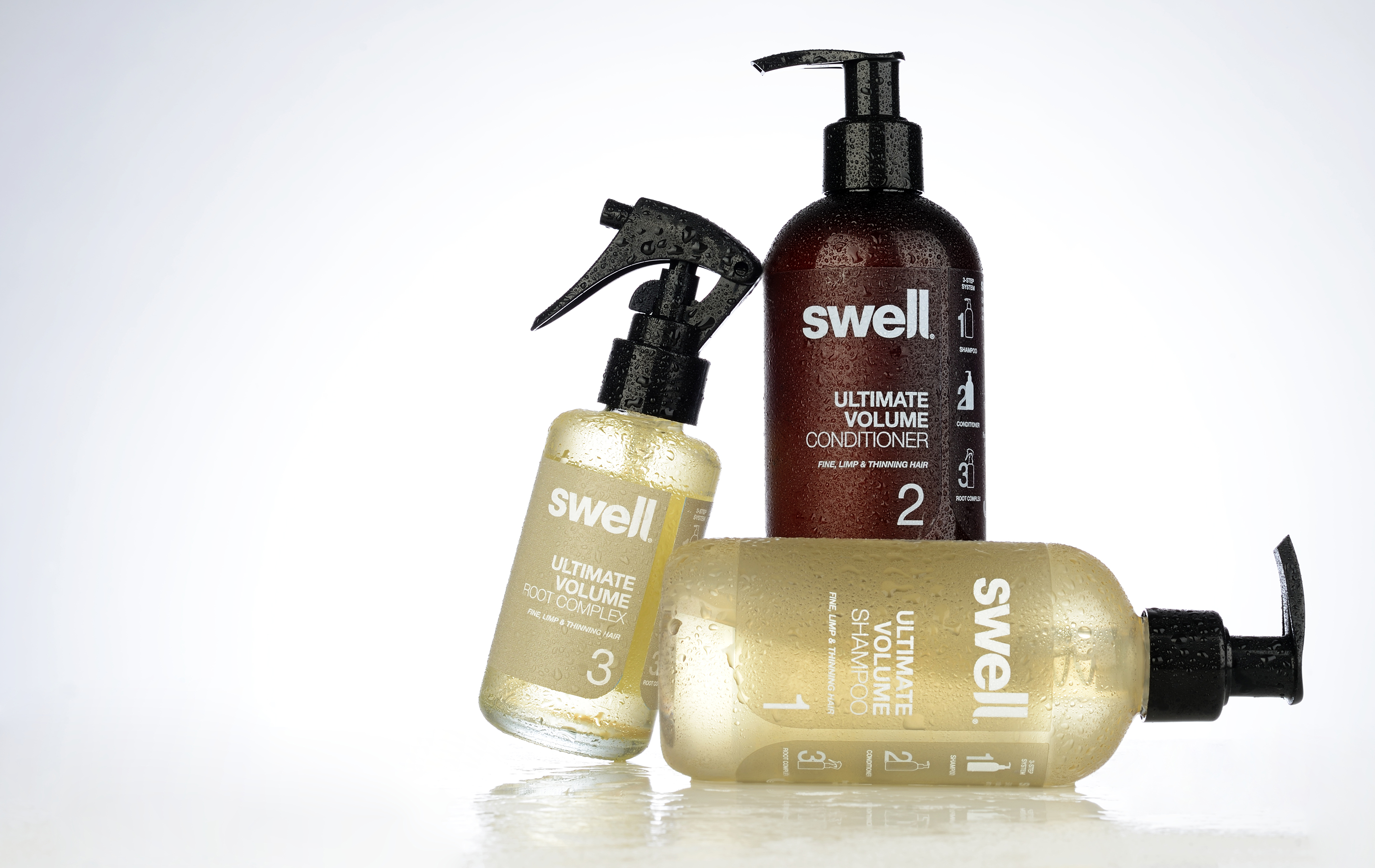 Hair care packaging design for Swell Hair. Image shot of Swell shampoo, conditioner and root complex. Packaging design by Flipflop Design Ltd.