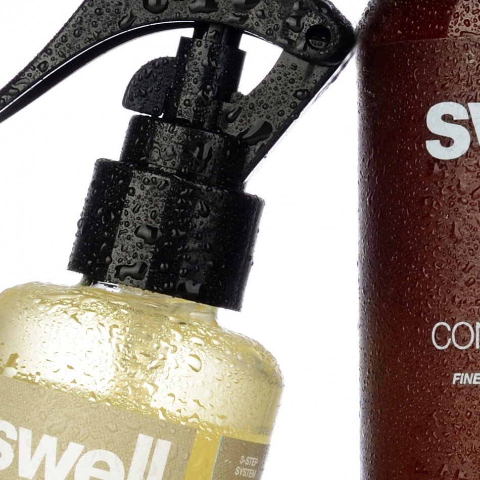 Hair care packaging design for Swell Hair. Cropped Image shot of Swell Conditioner and Root Complex. Packaging design by Flipflop Design Ltd.