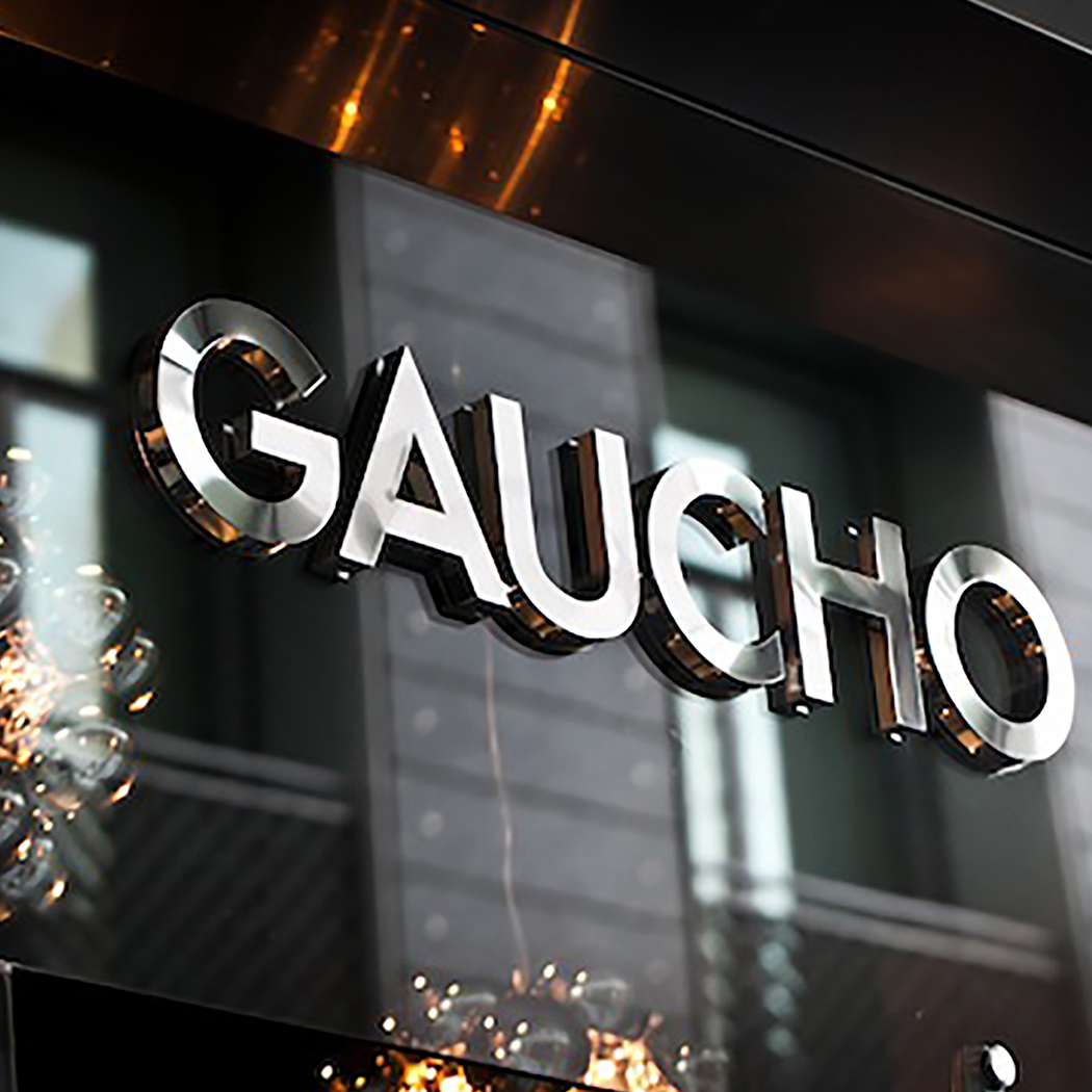 Gaucho Restaurants logo in silver on the front of a restaurant.