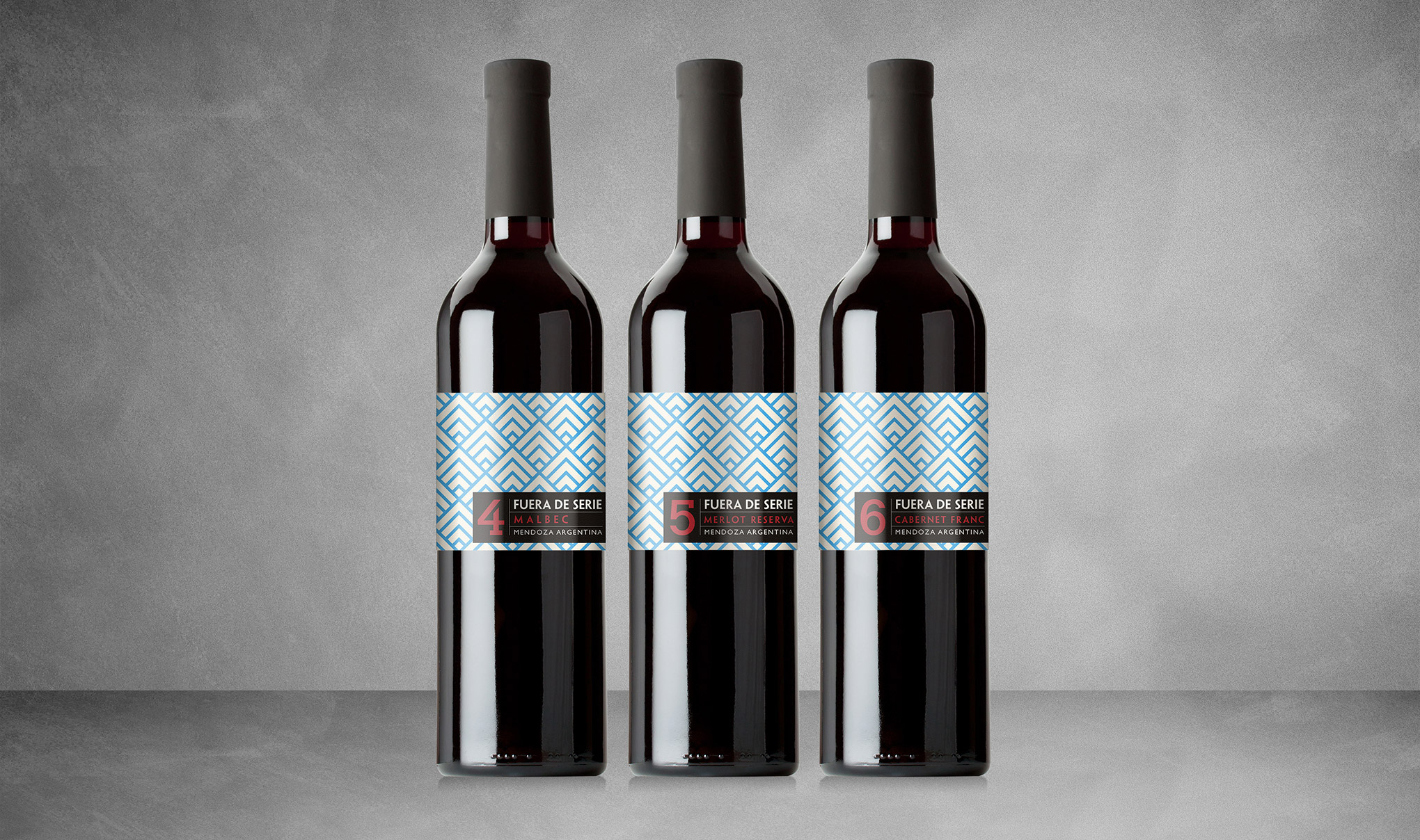 Wine label design for Fuera De Serie wine. 3 bottles in a row showing different wines. Designed for Gaucho restaurants by creative agency, Flipflop Design Ltd.