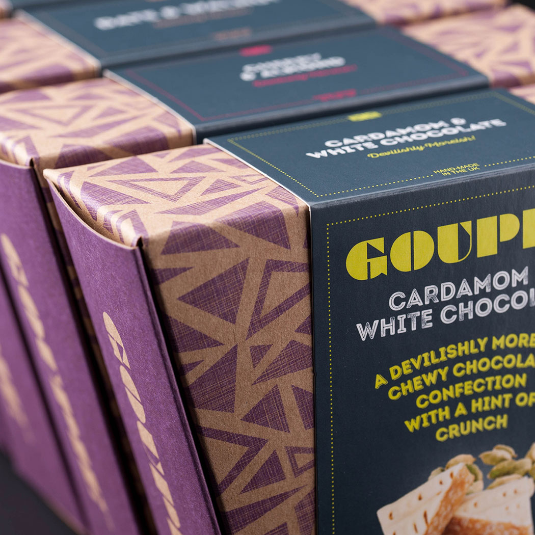 Chocolate packaging design. Tightly cropped image shot of the new trapezoid cartons lined up. Designed by - Flipflop Design Ltd.