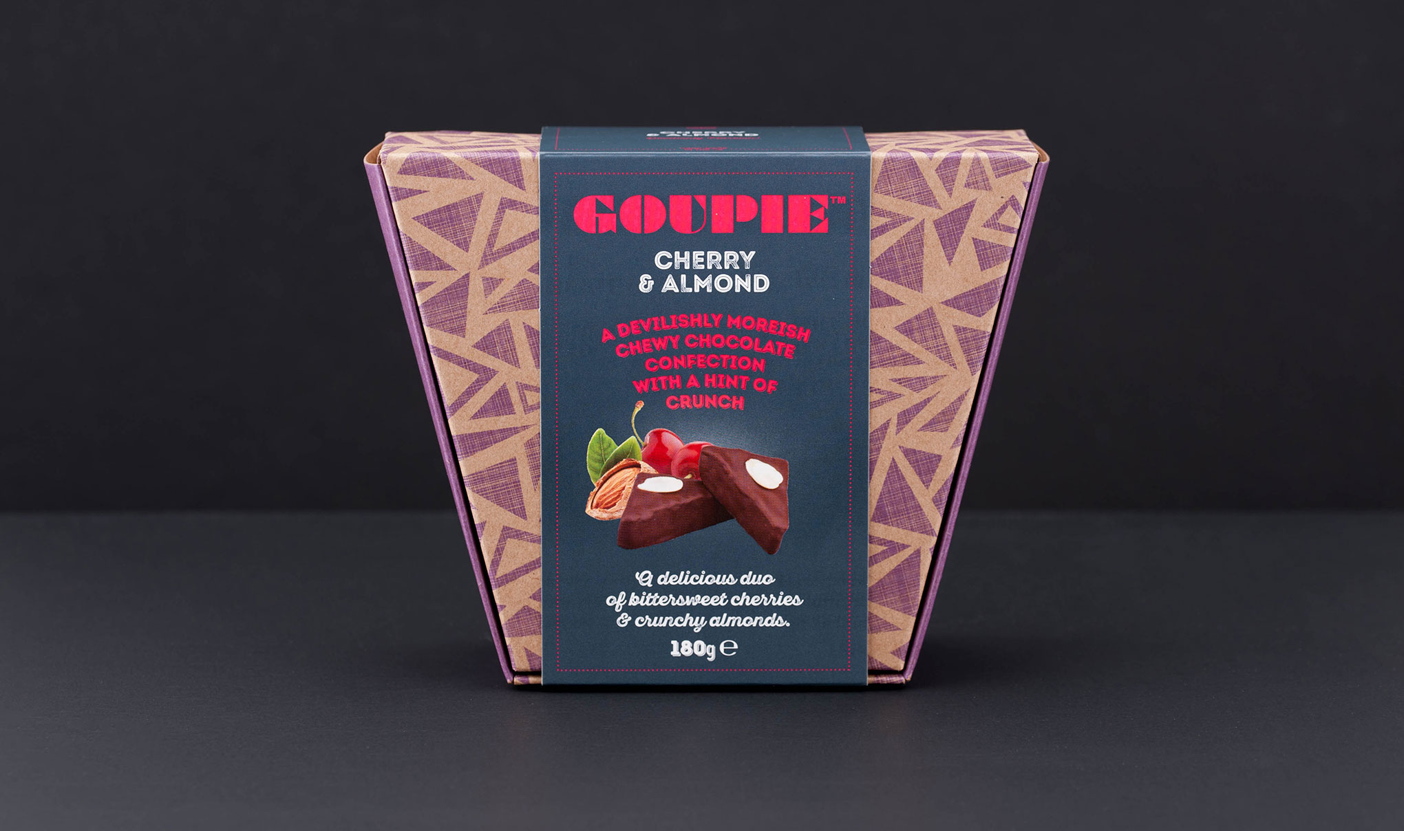 Chocolate packaging design. Front on image shot of the new trapezoid carton with band wrap. Designed by packaging design agency - Flipflop Design Ltd.
