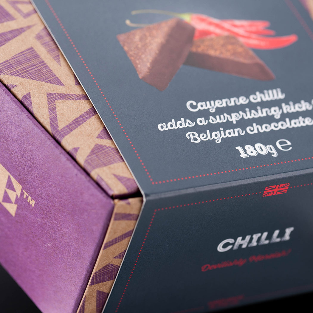Chocolate packaging design. Angled view, tightly cropped image shot of the new trapezoid carton & flavour band wrap. Designed by packaging design agency - Flipflop Design Ltd.