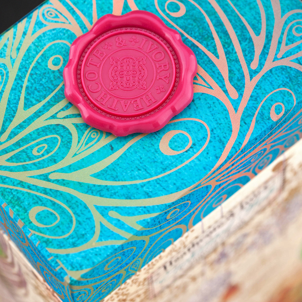 Packaging Design for Heathcote & Ivory's Xmas Gift range. Image shows Embossed Stamp Detail Which Sits on Top of the Cartons.