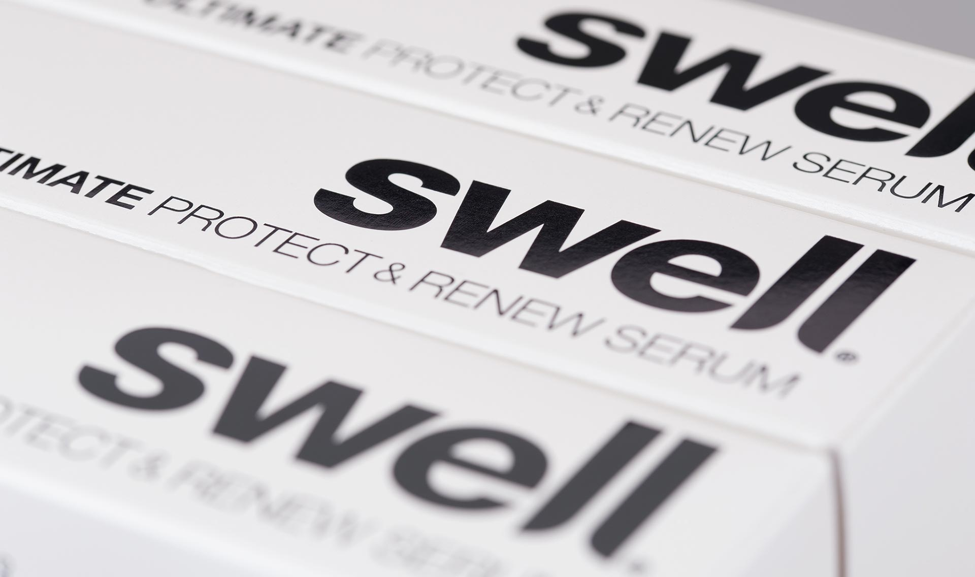 Haircare packaging design for Swell Hair. Protect & Renew Serum carton. Packaging design agency - Flipflop Design.