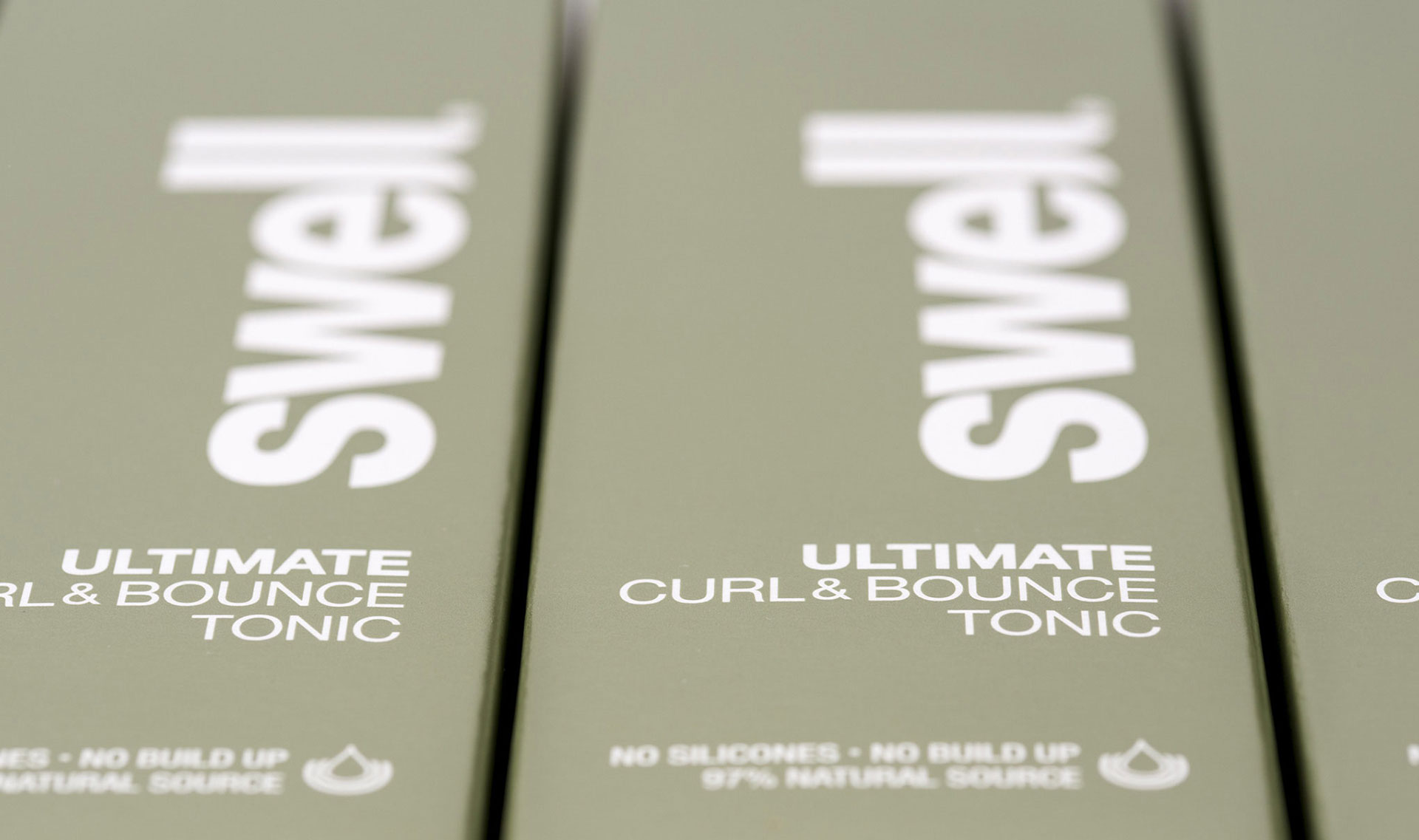 Haircare package design for Swell Hair. Curl & Bounce Tonic carton. Packaging design company - Flipflop Design.