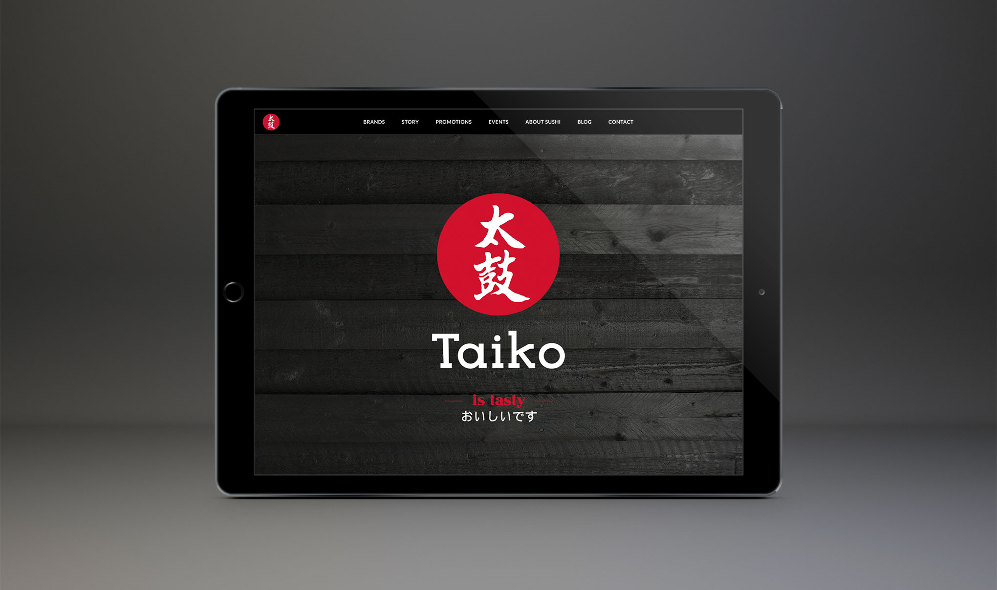 Website Design for Taiko Sushi. Image shows home page on an iPad. Created by Brighton web design agency - Flipflop Design.