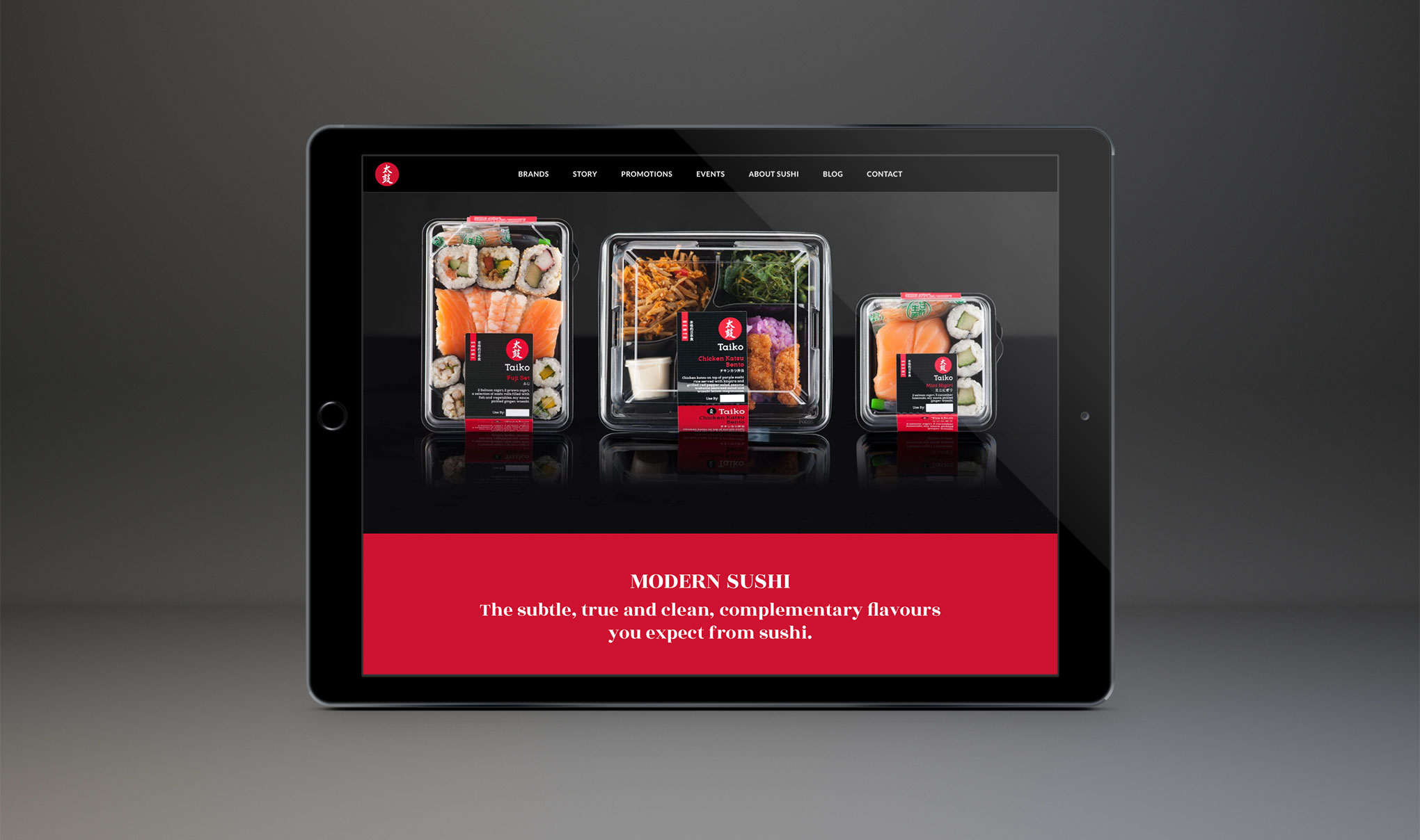 Website Design for Taiko Sushi. Image of an iPad showcasing three sushi meals and marketing text on the homepage. Created by web design agency - Flipflop Design, Brighton