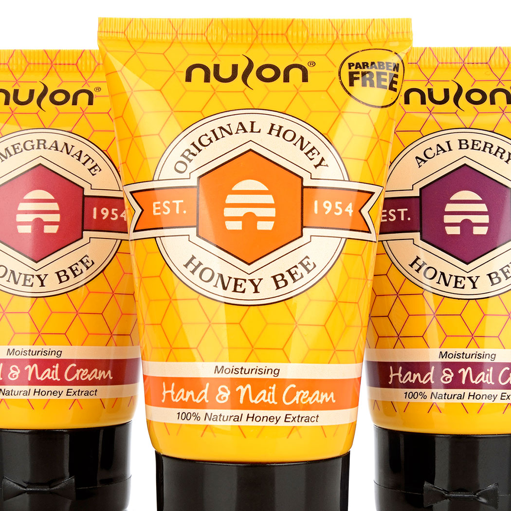 Packaging design for 'Honey Bee' honey extract hand cream. Image shows x3 product variants lined up. Designed by packaging design agency - Flipflop Design.