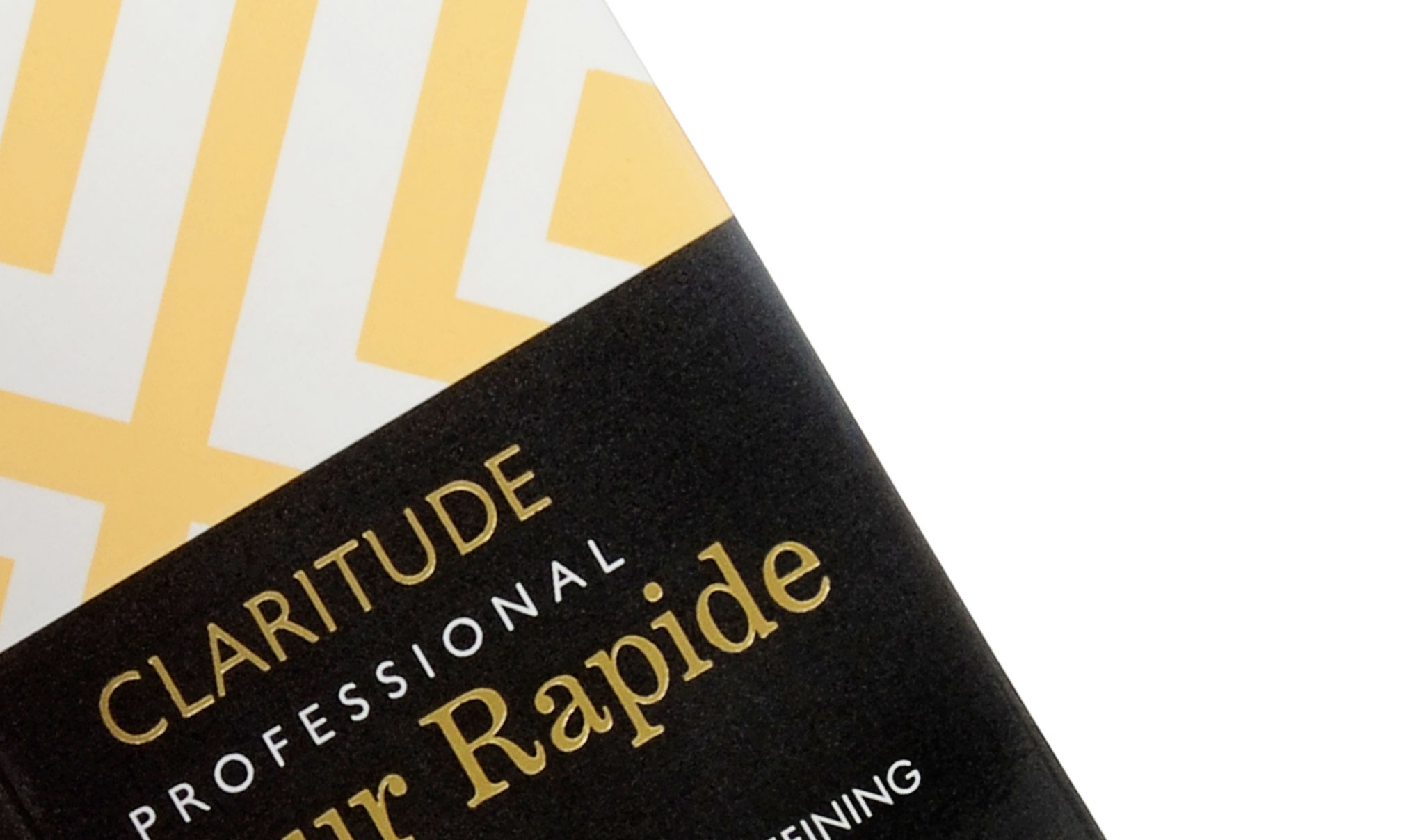 Geometric Packaging Design for Claritude Root Touch-up. Image shows a tight crop shot of the blonde variation. Created by brand and packaging design agency - Flipflop Design Ltd