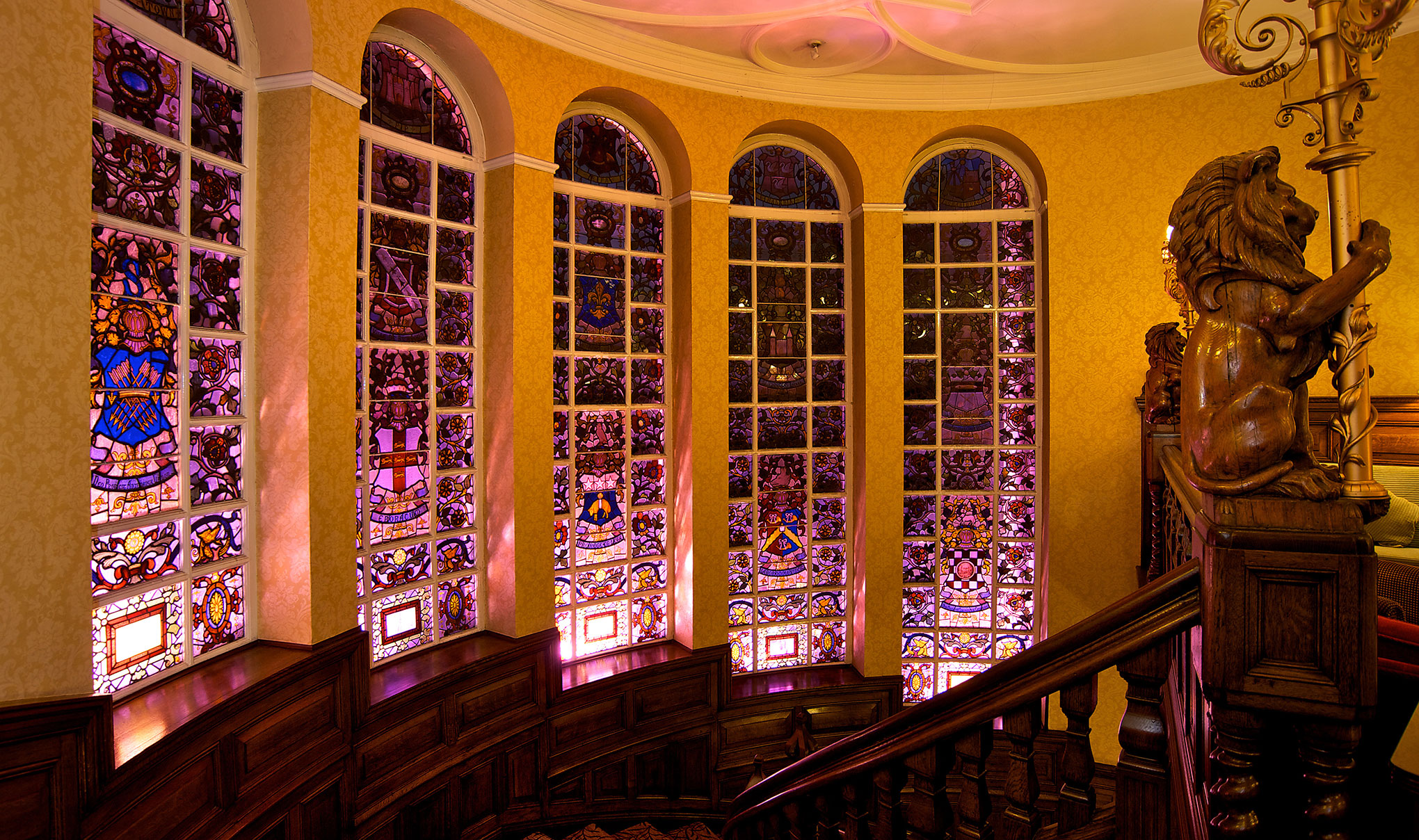 The grand staircase of Quebecs hotel in Leeds. 5 stained glass windows and carved staircase.