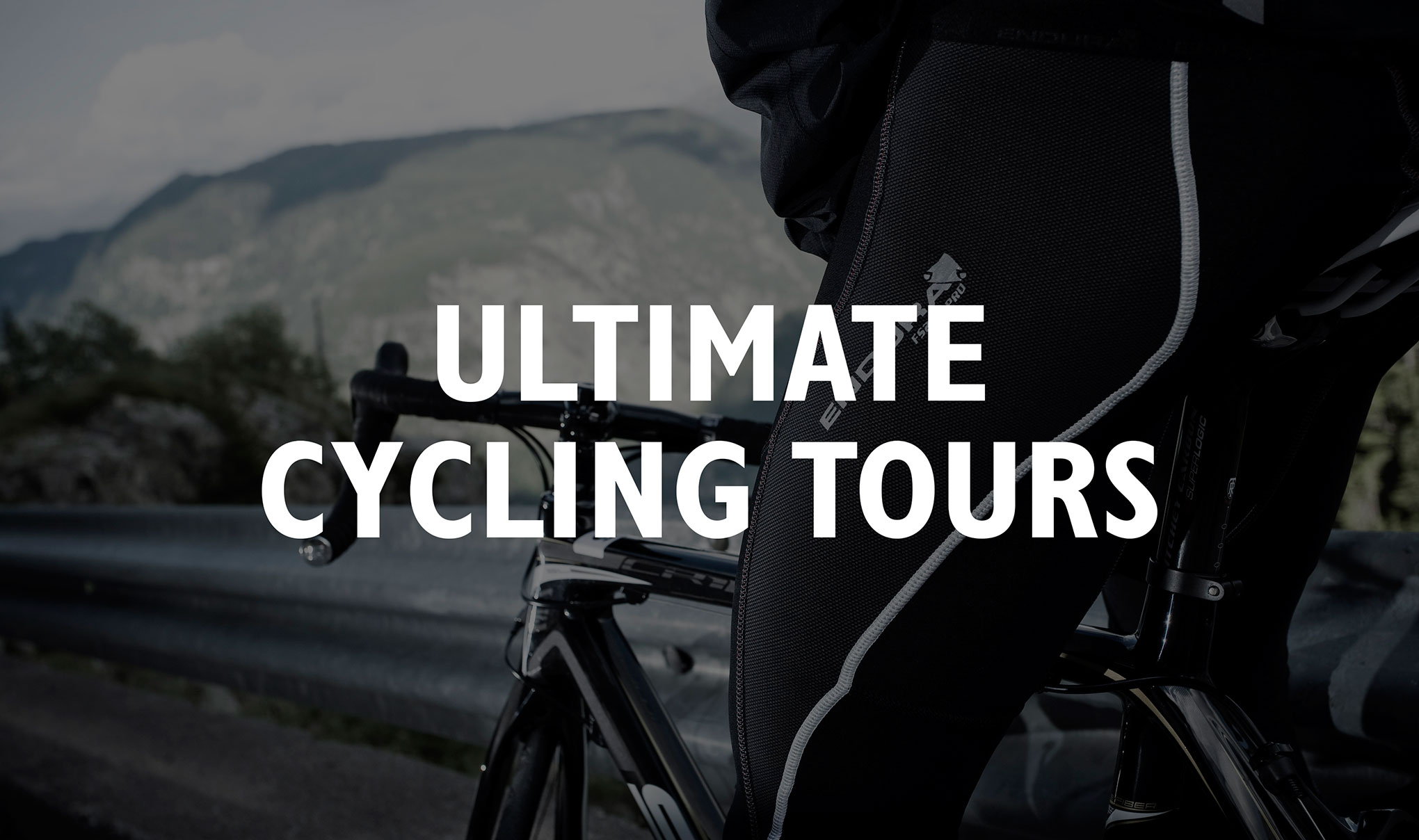 Text ' Ultimate Cycling Tours' written in white over a black & white cropped image of a cyclist sitting on a bike looking out at the view of the Alps.